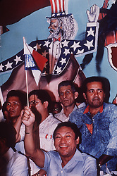 In front of a mural depicting an evil Uncle Sam, Panamanian dictator Manuel Noriega acknowledges supporters during an anti- U.S rally outside of Panama City in 1988. One-time Panamanian dictator Manuel Noriega is being remembered as a ruthless strongman of volatile CIA operative and a brash drug trafficker. Noriega was removed from office in the 1989 U.S. invasion of Panama. He died last night at 83. Photo by David Walters/The Miami Herald/TNS/ABACAPRESS.COM