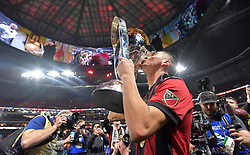 December 8, 2018 - Atlanta, GA, USA - Atlanta United midfielder Miguel Almiron (10) kisses the MLS cup after United's 2-0 victory over the Portland Timbers on Saturday, Dec 8, 2018, in Atlanta. (Credit Image: © Hyosub Shin/Atlanta Journal-Constitution/TNS via ZUMA Wire)