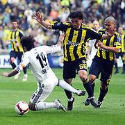 Fenerbahce's Alexsandro de SOUZA (R) and Mehmet TOPUZ (C) during their Turkish superleague soccer derby match Fenerbahce between Besiktas at Sukru Saracaoglu stadium in Istanbul Turkey on Sunday 18 April 2010. Photo by /TURKPIX
