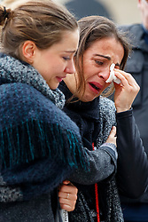 © Licensed to London News Pictures. 16/11/2015. Paris, France. Mourners visit a memorial outside Le Petit Cambodge in Paris, France following the Paris terror attacks on Monday, 16 November 2015. Photo credit: Tolga Akmen/LNP