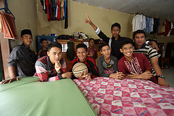 Unnamed boys in the same class as  Bahagia Rahmatullah  (Rahmat) at the Islamic boarding school in Banda Aceh where they stays all week, Aceh Province, Sumatra, Indonesia