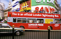 Photo of a sightseeing bus at Picadilly Circus in London, England