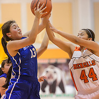 Gallup JV Bengal Saraanne Shirley (44) and Navajo Pine Warrior Angelene Yazzie (13) compete for a rebound Thursday at Wingate High School.