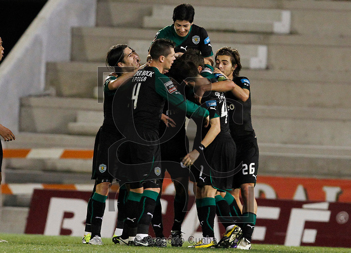 Players of Sporting´s Lisbon celebrate after scoring a goal against the Marítimo ,during the Portuguese First League soccer match held at the Barreiros stadium in Funchal , Portugal, 24 January 2011..Photo Gregorio Cunha