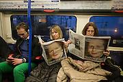 London 8/4/2013 - Londoners on the London underground from Heathrow, read of the death of ex-British Prime Minister, Baroness Margaret Thatcher whose death was announced on April 8th, 2013 in London. Thatcher (known to Britons as Maggie) served as leader of the Conservative party then Prime Minister of Britain from 1979 to 1990 and passed away peracefully from a stroke at age 87.