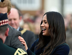 Meghan Markle reacts while on a walkabout on the esplanade at Edinburgh Castle, as she and Prince Harry visited Scotland.
