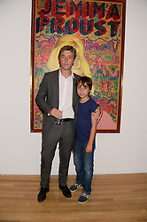 BAXTER DURY son of Ian Dury and his son KOSMO DURY at a private view of the late Ian Dury's artwork entitled Ian Dury: More Than Fair – Paintings, drawings and artworks, 1961–1972 held at the Royal College of Art, Kensington Gore, London SW7 on 22nd July 2013.