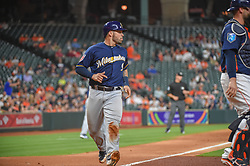 March 26, 2018 - Houston, TX, U.S. - HOUSTON, TX - MARCH 26: Milwaukee Brewers catcher Manny Pina (9) scores in the top of the third during the game between the Milwaukee Brewers and Houston Astros at Minute Maid Park on March 26, 2018 in Houston, Texas. (Photo by Ken Murray/Icon Sportswire) (Credit Image: © Ken Murray/Icon SMI via ZUMA Press)