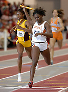 Chaunte Bayne of Texas holds of Latosha Wallace of Arizona State on the anchor of the women's 4 x 400-meter relay in the NCAA Indoor Track & Field Championships at the Randal Tyson Track Center at the University of Arkansas in Fayetteville, Ark. on Saturday, March 10, 2007. Texas and Arizona State timed 3:36.02 and 3:36.17 for the Nos. 8 and 9 marks.