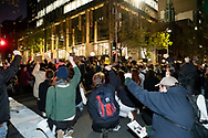 Protesters bend on one knee at Martin Place during a 'Black Lives Matter' rally on 02 June, 2020 in Sydney, Australia. This event was organised to rally against aboriginal deaths in custody in Australia as well as in unity with protests across the United States following the killing of an unarmed black man George Floyd at the hands of a police officer in Minneapolis, Minnesota. (Photo by Steven Markham/ Speed Media)