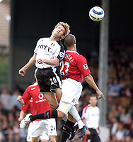 Photo: Daniel Hambury.<br />Fulham v Manchester United. The Barclays Premiership. 01/10/2005.<br />Fulham's Brian McBride beats Manchester Utd's Mikael Silvestre in the air to set Fulham first goal scorer Collins Johgn on his way.