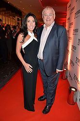 CHRISTOPHER BIGGINS and KATRINA SHALIT at a party to celebrate the 21st anniversary of The Roar Group hosted by Jonathan Shalit held at Avenue, 9 St.James's Street, London on 21st September 2015.