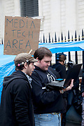 "Media Tech Area being set up to aid techinical support. Wifi coming soon! Occupy London protest at St Pauls, October 16th 2011. Protest spreads from the US with this demonstrations in London and other cities worldwide. The 'Occupy' movement is spreading via social media. After four weeks of focus on the Wall Street protest, the campaign against the global banking industry started in the UK this weekend, with the biggest event aiming to ""occupy"" the London Stock Exchange. The protests have been organised on social media pages that between them have picked up more than 15,000 followers. Campaigners gathered outside  at midday before marching the short distance to Paternoster Square, home of the Stock Exchange and other banks.It is one of a series of events planned around the UK as part of a global day of action, with 800-plus protests promised so far worldwide.Paternoster Square is a private development, giving police more powers to not allow protesters or activists inside."