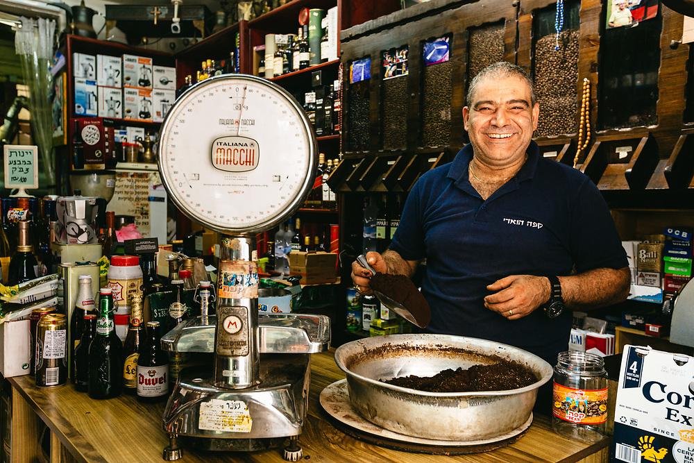 Daoud Marian sells freshly roasted coffee at his shop in Wadi Nisnas, an Arab neighborhood in the city of Haifa, Northern Israel.