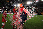 Queensland coach Ewen McKenzie is drenched by his players following the Queensland Reds victory in the Super Rugby Final at Suncorp Stadium in Brisbane,  July 9, 2011.  Photo: Patrick Hamilton/Photosport