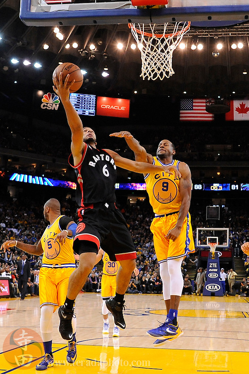 November 17, 2015; Oakland, CA, USA; Toronto Raptors guard Cory Joseph (6) shoots the basketball against Golden State Warriors guard Andre Iguodala (9) during the third quarter at Oracle Arena. The Warriors defeated the Raptors 115-110.