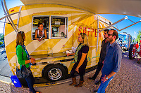 Waitress talks to customers, The Supper Truck (food truck), Albuquerque, New Mexico USA