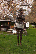Statue of woman made from odds and ends, Pony, Montana