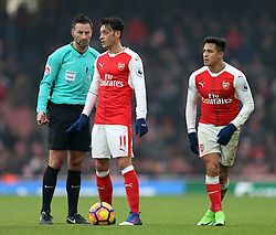 11 February 2017 Premier League Football : Arsenal v Hull City :<br /> Mesut Ozil and Alexis Sanchez (right) of Arsenal await the whistle from referee Mark Clattenburg, before a free kick can be taken.<br /> Photo: Mark Leech