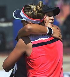 September 20, 2017 - U.S. - SPORTS -- Marina Erakovic of New Zealand, left, gets a hug from Laura Robson of Great Britain after winning her singles match over Robson during the ColemanVision Tennis Championship at the Tanoan Country Club on Wednesday, September 20, 2017. The two are doubles partners. (Greg Sorber/Albuquerque Journal (Credit Image: © Greg Sorber/Albuquerque Journal via ZUMA Wire)