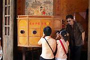 Children watch a puppet show in Shanghai, China.