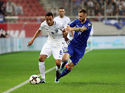 ATHENS, Nov. 13, 2017  Croatia's Luka Modric (R) vies with Greece's Zeca during the second leg of World Cup 2018 Qualifiers playoff match between Greece and Croatia in Piraeus, Greece, Nov. 12, 2017. (Credit Image: © Marios Lolos/Xinhua via ZUMA Wire)