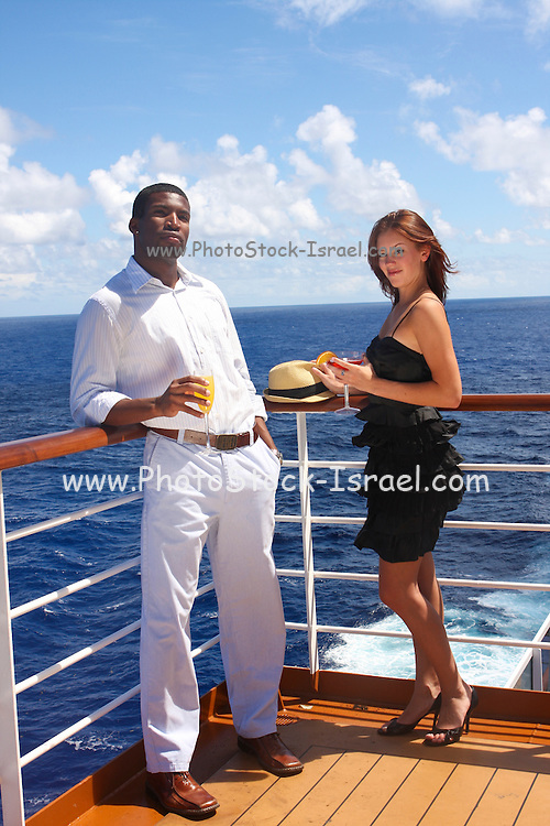 a couple drinks cocktails  on a deck of a cruise ship