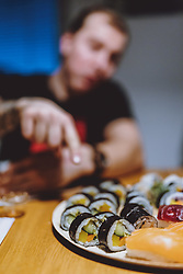THEMENBILD - Sushi von einem Restaurant nach Hause geliefert, aufgenommen am 05. Feber 2021 in Kaprun, Österreich // Sushi delivered from a restaurant at home, Kaprun, Austria on 2021/02/05. EXPA Pictures © 2021, PhotoCredit: EXPA/ JFK