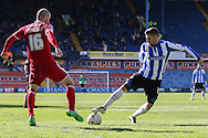 Sheffield Wednesday striker Gary Hooper (14) and Cardiff City defender, Matthew Connolly (16) during the Sky Bet Championship match between Sheffield Wednesday and Cardiff City at Hillsborough, Sheffield, England on 30 April 2016. Photo by Ellie Hoad.