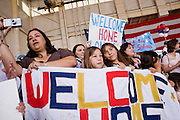 "30 MARCH 2008 -- PHOENIX, AZ: The family members of Arizona National Guard soldiers wait for their loved ones to come home from Afghanistan in an Air Force hanger in Phoenix, AZ, Sunday. About 250 members of the Arizona Army National Guard's 158th Infantry Battalion returned to Phoenix, AZ, from a year long deployment in Afghanistan Sunday. The unit, also known as the ""Bushmasters"" from their service in World War II, was part of the largest single-unit deployment of the Arizona National Guard since the second World War. Two members of the battalion were killed in action during their deployment. The battalion, a combat unit, engaged in counter insurgency operations through out their deployment. Photo by Jack Kurtz / ZUMA Press"