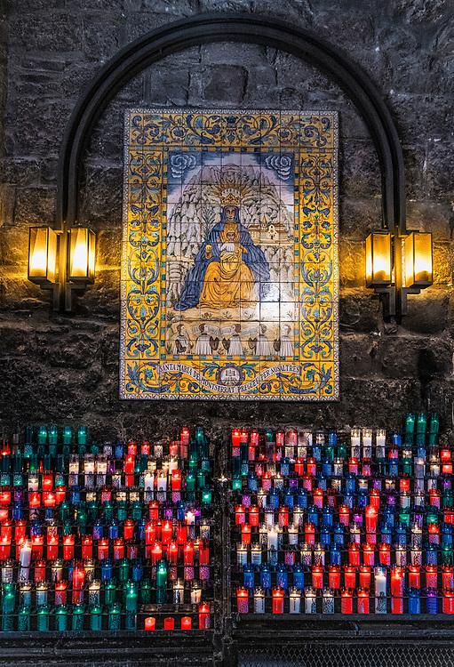 Votive candles to an icon of Santa Maria de Montserrat Abbey, Monistrol de Montserrat,  Catalonia, Spain