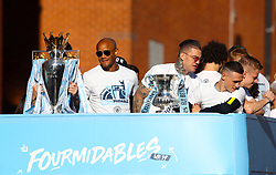 Manchester City's Vincent Kompany (left) and de Moraes Ederson (right) during the trophy parade in Manchester.
