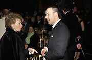 Lily Safra and David Furnish, Valentino couture show, Ecole Nationale Superiore des Beaux -Arts, rue Bonaparte. After party at the Ritz. 23 January  2006.  ONE TIME USE ONLY - DO NOT ARCHIVE  © Copyright Photograph by Dafydd Jones 66 Stockwell Park Rd. London SW9 0DA Tel 020 7733 0108 www.dafjones.com