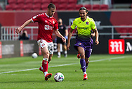 Bristol City's Tommy Rowe (25) under pressure from Exeter City's Randell Williams (11) during the EFL Cup match between Bristol City and Exeter City at Ashton Gate, Bristol, England on 5 September 2020.