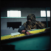 A laborer at a peanut factory outside of Kabul.