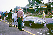 Pat Coundley in car, John Coundley standing driver's side in blue overalls facing camera, Jaguar D-type, Goodwood Whitsun Sports car race 3 June 1963