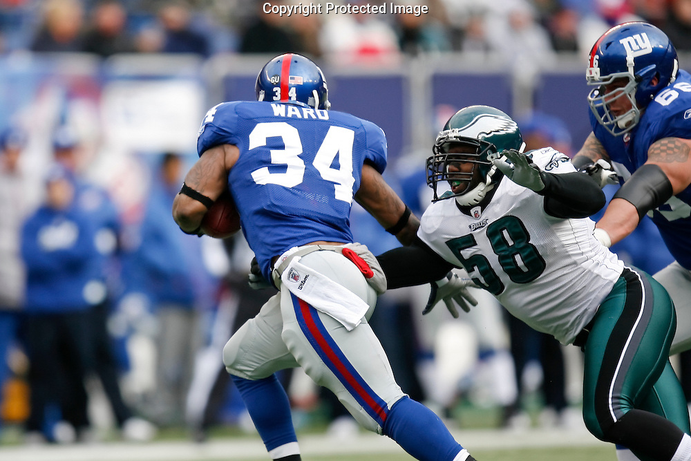 7 Dec 2008: Philadelphia Eagles defensive end Trent Cole #58 tackles New York Giants running back Derrick Ward #34 during the game against the New York Giants on December 7th, 2008. The Eagles won 20-14 at Giants Stadium in East Rutherford, New Jersey.