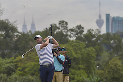 October 14, 2018 - Kuala Lumpur, Malaysia - Marc Leishman of Australia plays a shot during the final round of CIMB Classic golf tournament in Kuala Lumpur, Malaysia on October 14, 2018. (Credit Image: © Zahim Mohd/NurPhoto via ZUMA Press)
