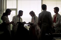 Stock photo of doctors meeting and making rounds