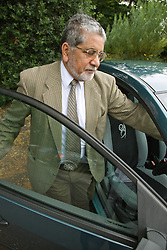 older man getting into his car,