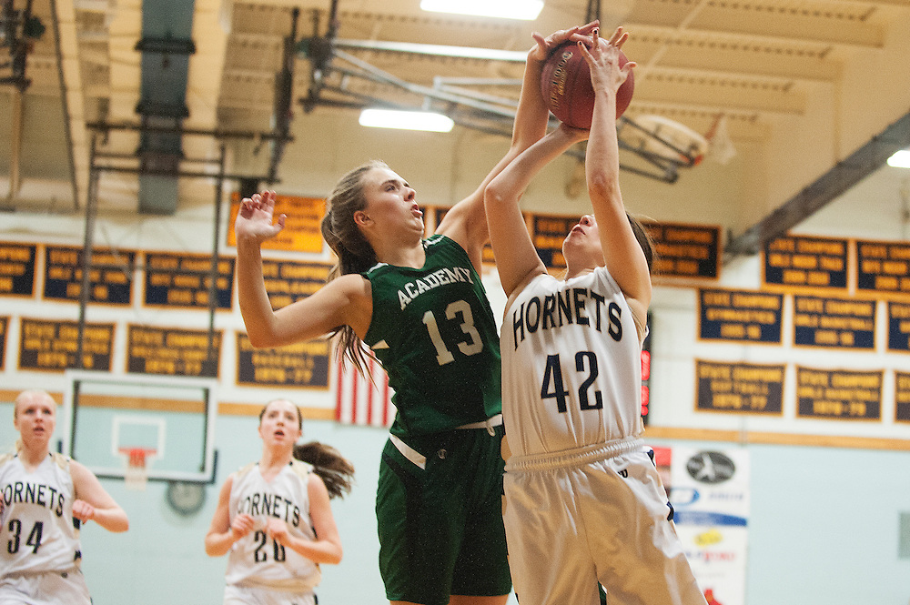 St. Johnsbury's Gunnhidur Atladottir (13) blocks the shot by Essex's Jordan Dumouchel (40) during the girls basketball game between the St. Johnsbury Hilltoppers and the Essex Hornets at Essex high school on Tuesday night January 5, 2016 in Essex. (BRIAN JENKINS/for the FREE PRESS)