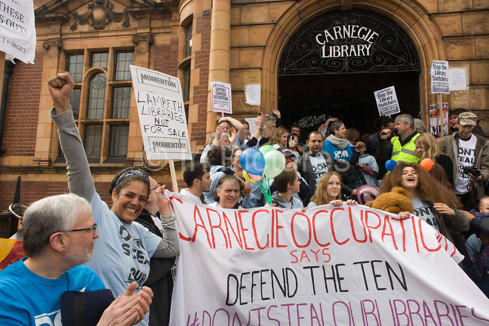 Campaigners against the closure by Lambeth council  of Carnegie Library in Herne Hill, south London, emerge from the premises into the street on their 10th day of occupation, 9th April 2016. The local community have been occupying their important resource for learning and social hub and after a long campaign, Lambeth have gone ahead and closed the librarys doors for the last time because they say, cuts to their budget mean millions must be saved. They plan to re-purpose it into a gym although details are unknown.