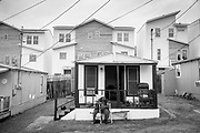RL waits for his ride to weekly dialysis treatment in front of his home on E 12th Street in Austin, Texas. The area is under pressure from developers as gentrification sweeps the neighborhood.