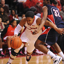 Mar 2, 2009; Piscataway, NJ, USA; Rutgers guard Khadijah Rushdan (1) drives to the net against Connecticut guard Kalana Greene (32) during the second half of Rutgers game against nationally rated #1 Connecticut at the Louis Brown Athletic Center.  Connecticut won 69-59 to finish their regular season a perfect 30-0.