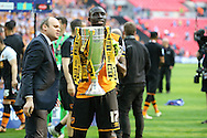 Mohamed Diame of Hull City poses with the Sky Bet Championship Playoff Trophy.Skybet football league Championship play off final match, Hull city v Sheffield Wednesday at Wembley Stadium in London on Saturday 28th May 2016.<br /> pic by John Patrick Fletcher, Andrew Orchard sports photography.