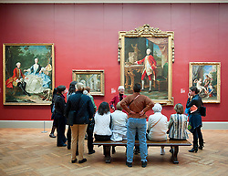 Tour group listening to art guide at Metropolitan Museum of Art in Manhattan , New York City, USA