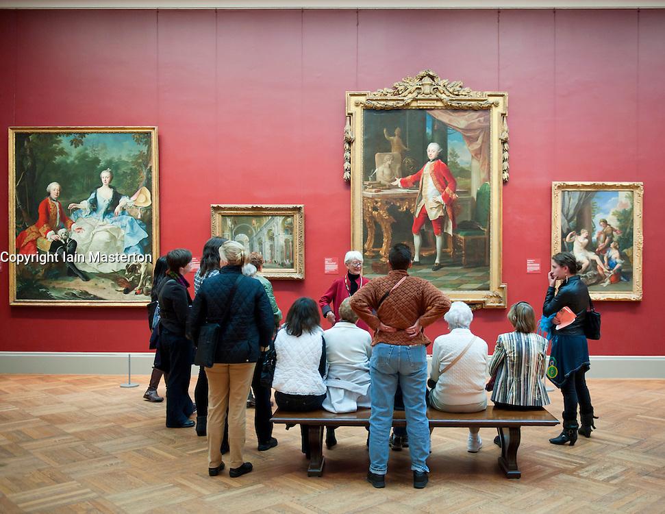 Tour group listening to art guide at Metropolitan Museum of Art in Manhattan , New York City, USA