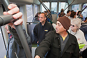 27 DECEMBER 2008 -- PHOENIX, AZ: At 10:10AM Chad Neyland gripped a handle on his train ride north out of downtown. Phoenix will soon have their own version of strap hangers, common in New York and other towns with mass transit. Metro Light Rail started running Saturday, Dec. 28. The light rail line is 20 miles long and cost $1.4 billion dollars. PHOTO BY JACK KURTZ