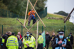 An anti-HS2 activist releases himself from a tripod used to block one of several entrances to the Chiltern Tunnel South Portal site for the HS2 high-speed rail link for the entire day on 9 October 2020 in West Hyde, United Kingdom. The protest action, at the site from which HS2 Ltd intends to drill a 10-mile tunnel through the Chilterns, was intended to remind Prime Minister Boris Johnson that he committed to remove deforestation from supply chains and to provide legal protection for 30% of UK land for biodiversity by 2030 at the first UN Summit on Biodiversity on 30th September.