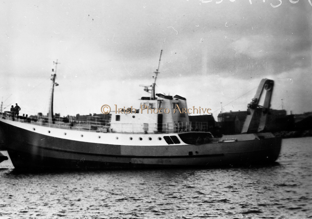23/06/1965<br /> 06/23/1965<br /> 23 June 1965<br /> Copy of photograph of fishing boat for Bord Iascaigh Mhara (B.I.M.). Location unknown <br /> The unknown trawler could be the Miss Trudle or Miss Cicille owned or managed by Clayton Love ltd. (comment william power)
